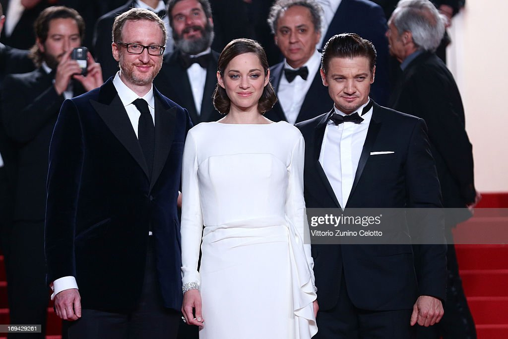 Director <a gi-track='captionPersonalityLinkClicked' href=/galleries/search?phrase=James+Gray&family=editorial&specificpeople=2479723 ng-click='$event.stopPropagation()'>James Gray</a>, actors <a gi-track='captionPersonalityLinkClicked' href=/galleries/search?phrase=Marion+Cotillard&family=editorial&specificpeople=215303 ng-click='$event.stopPropagation()'>Marion Cotillard</a> and <a gi-track='captionPersonalityLinkClicked' href=/galleries/search?phrase=Jeremy+Renner&family=editorial&specificpeople=708701 ng-click='$event.stopPropagation()'>Jeremy Renner</a> leave 'The Immigrant' Premiere during the 66th Annual Cannes Film Festival at Grand Theatre Lumiere on May 24, 2013 in Cannes, France.