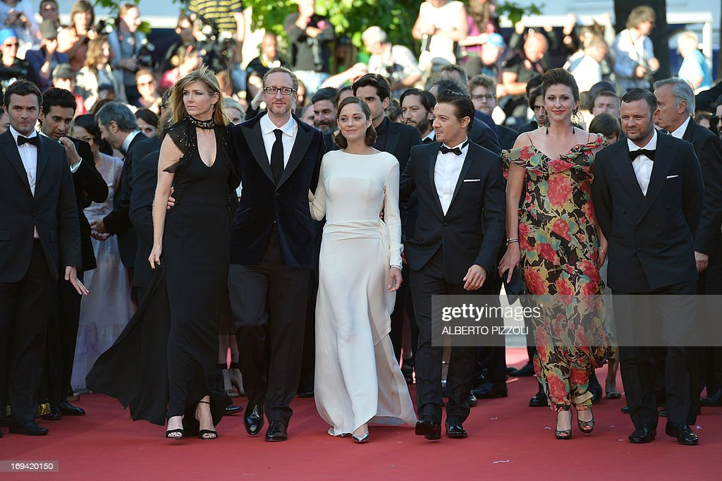 US director James Gray (2ndL) and his wife Alexandra Dickson (L), French actress Marion Cotillard (C) and US actor Jeremy Renner (3rdR) arrive on May 24, 2013 for the screening of the film 'The Immigrant' presented in Competition at the 66th edition of the Cannes Film Festival in Cannes. Cannes, one of the world's top film festivals, opened on May 15 and will climax on May 26 with awards selected by a jury headed this year by Hollywood legend Steven Spielberg.