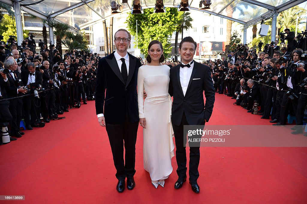 US director James Gray, French actress Marion Cotillard and US actor Jeremy Renner pose on May 24, 2013 as they arrive for the screening of the film 'The Immigrant' presented in Competition at the 66th edition of the Cannes Film Festival in Cannes. Cannes, one of the world's top film festivals, opened on May 15 and will climax on May 26 with awards selected by a jury headed this year by Hollywood legend Steven Spielberg.