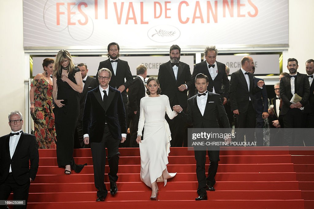 US director James Gray, French actress Marion Cotillard and US actor Jeremy Renner leave on May 24, 2013 after attending the screening of the film 'The Immigrant' presented in Competition at the 66th edition of the Cannes Film Festival in Cannes. Cannes, one of the world's top film festivals, opened on May 15 and will climax on May 26 with awards selected by a jury headed this year by Hollywood legend Steven Spielberg.