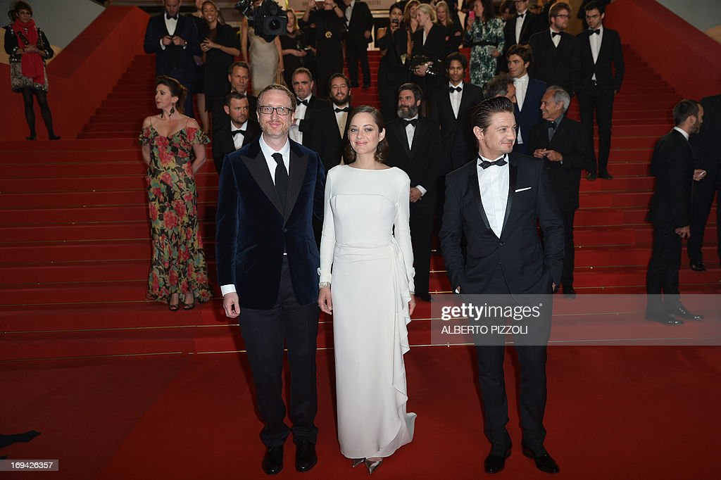 US director James Gray, French actress Marion Cotillard and US actor Jeremy Renner pose on May 24, 2013 after the screening of the film 'The Immigrant' presented in Competition at the 66th edition of the Cannes Film Festival in Cannes. Cannes, one of the world's top film festivals, opened on May 15 and will climax on May 26 with awards selected by a jury headed this year by Hollywood legend Steven Spielberg.