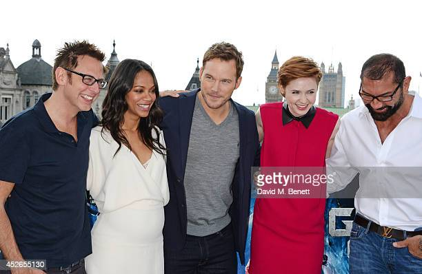 Director James Gunn and cast members Zoe Saldana Chris Pratt Karen Gillan and David Bautista pose at the 'Guardians of the Galaxy' photocall at The...
