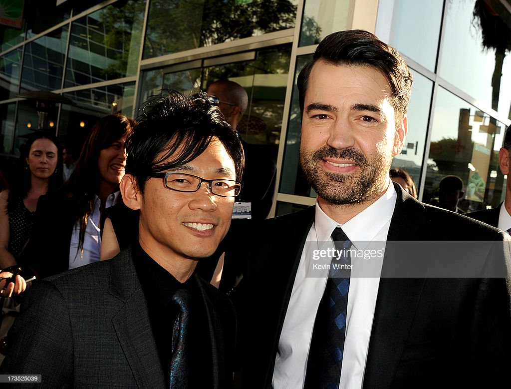 Director James Wan (L) and actor Ron Livingston arrive at the premiere of Warner Bros. 'The Conjuring' at the Cinerama Dome on July 15, 2013 in Los Angeles, California.