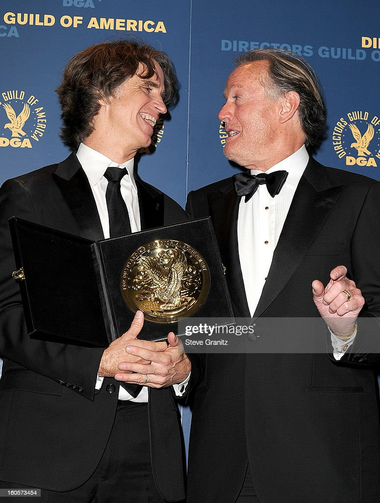 Director Jay Roach (L), winner of the Outstanding Directorial Achievement in Movies for Television and Mini-Series for 'Game Change,' and presenter Peter Fonda pose in the press room at the 65th Annual Directors Guild Of America Awards at The Ray Dolby Ballroom at Hollywood & Highland Center on February 2, 2013 in Hollywood, California.