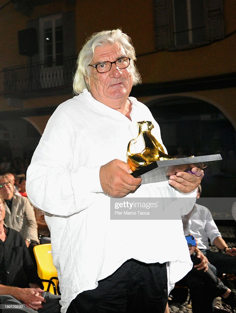 Director Jean- Claude Brisseau poses with the Pardo d'oro Grand Prize of the Festival award during the 65th Locarno Film Festival on August 11, 2012 in Locarno, Switzerland.