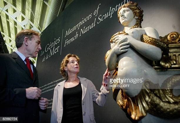 Director JeanNoel Gard and curator Marjolaine Mourot from the Musee national de la Marine Paris chat next to a mermaid figurehead from the bow of...