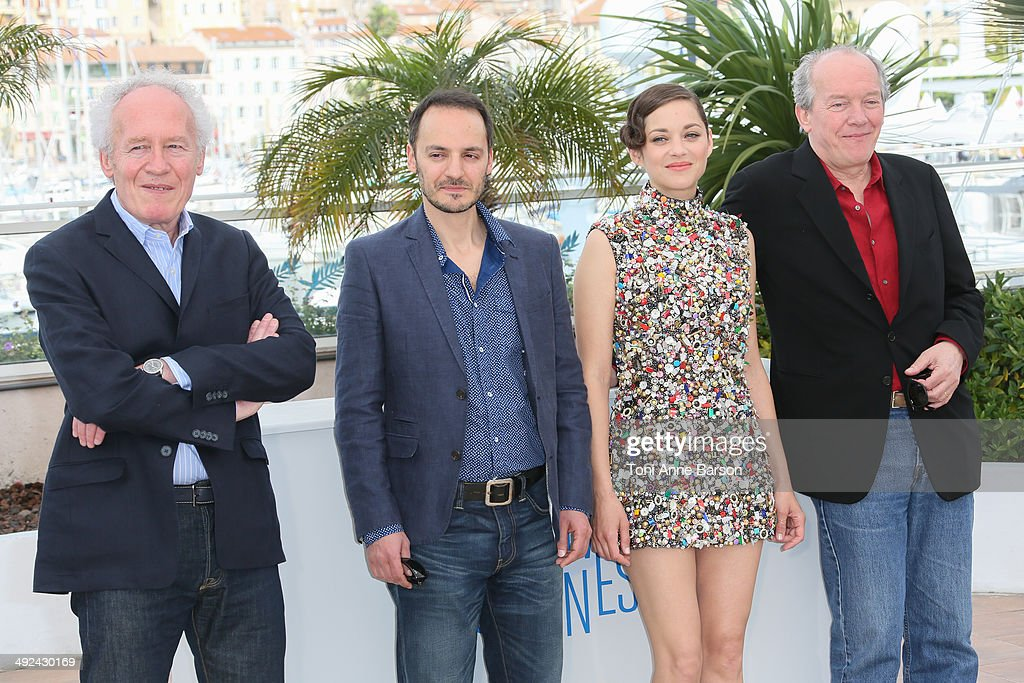 Director Jean-Pierre Dardenne, actor Fabrizio Rongione, actress Marion Cotillard and director Luc Dardenne attend the 'Two Days, One Night' photocall at the 67th Annual Cannes Film Festival on May 20, 2014 in Cannes, France.