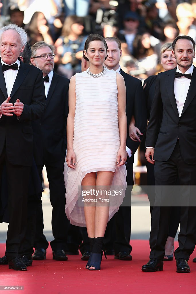 Director <a gi-track='captionPersonalityLinkClicked' href=/galleries/search?phrase=Jean-Pierre+Dardenne&family=editorial&specificpeople=606914 ng-click='$event.stopPropagation()'>Jean-Pierre Dardenne</a>, actors <a gi-track='captionPersonalityLinkClicked' href=/galleries/search?phrase=Marion+Cotillard&family=editorial&specificpeople=215303 ng-click='$event.stopPropagation()'>Marion Cotillard</a> and <a gi-track='captionPersonalityLinkClicked' href=/galleries/search?phrase=Fabrizio+Rongione&family=editorial&specificpeople=5349599 ng-click='$event.stopPropagation()'>Fabrizio Rongione</a> attend the 'Two Days, One Night' (Deux Jours, Une Nuit) premiere during the 67th Annual Cannes Film Festival on May 20, 2014 in Cannes, France.