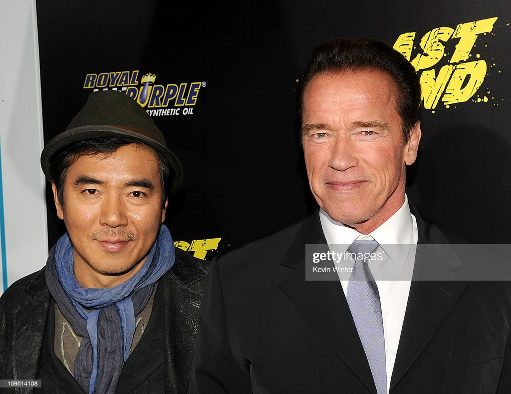 Director Jee-woon Kim (L) and actor <a gi-track='captionPersonalityLinkClicked' href=/galleries/search?phrase=Arnold+Schwarzenegger&family=editorial&specificpeople=156406 ng-click='$event.stopPropagation()'>Arnold Schwarzenegger</a> arrive at the premiere of Lionsgate Films' 'The Last Stand' at Grauman's Chinese Theatre on January 14, 2013 in Hollywood, California.