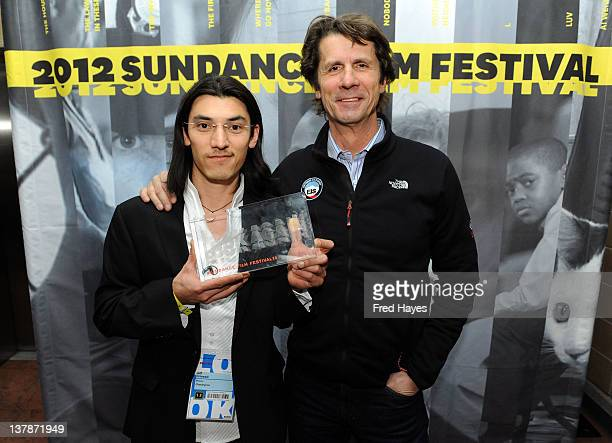Director Jeff Orlowski and James Balog pose with the award for Excellence In Cinematography Documentary for for 'Chasing Ice' at the Awards Night...