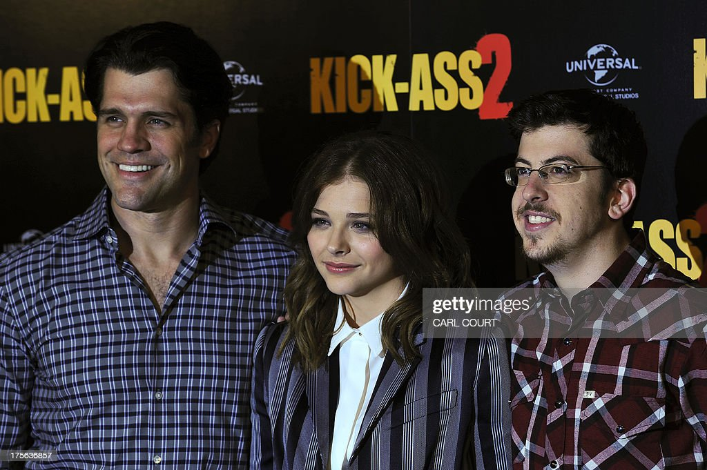 US director Jeff Wadlow and US actors Chloe Grace Moretz and Christopher Mintz-Plasse pose for photographers during a photocall to mark the UK launch of the film Kick Ass 2 in central London on August 5, 2013. AFP PHOTO / CARL COURT