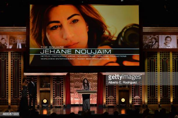 """Director Jehane Noujaim accepts the Outstanding Directorial Achievement in Documentary for """"The Square"""" from actor Don Cheadle onstage at the 66th..."""