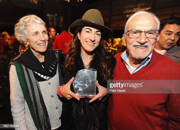 Director Jehane Noujaim winner of the Audience Award World Cinema Documentary for The Square poses with her parents at Awards Night Ceremony during...