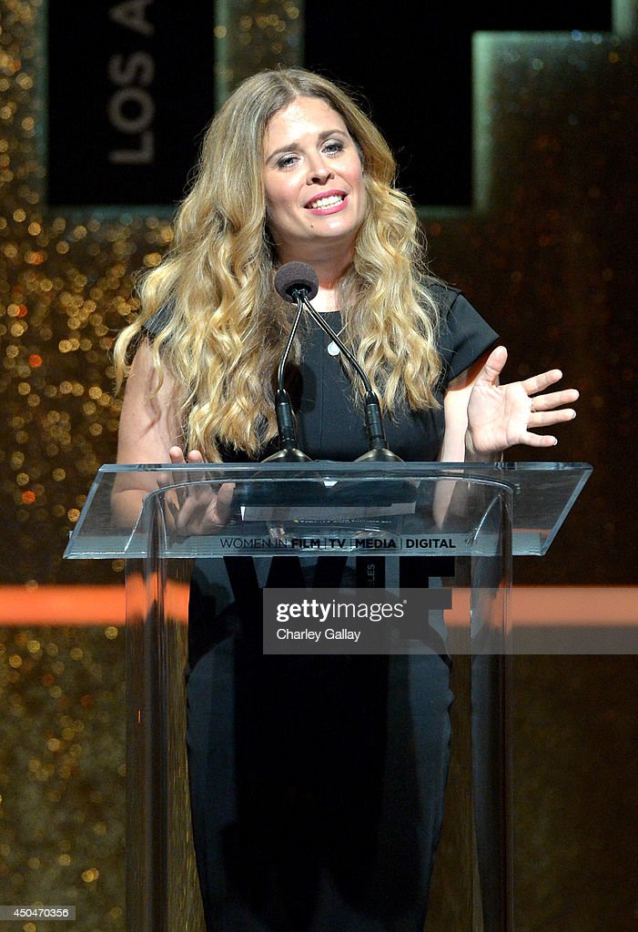Director Jennifer Lee accepts the Dorothy Arzner Directors Award onstage at Women In Film 2014 Crystal + Lucy Awards presented by MaxMara, BMW, Perrier-Jouet and South Coast Plaza held at the Hyatt Regency Century Plaza on June 11, 2014 in Los Angeles, California.