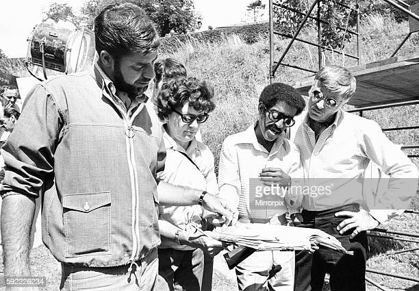 Director Jerry Lewis seen here reading the script with Sammy Davis Junior and Peter Lawford whilst on location at Eastnor Castle Ledbury during...