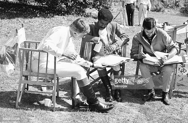Director Jerry Lewis seen here reading the script with Sammy Davis Junior centre and Peter Lawford whilst on location at Eastnor Castle Ledbury...