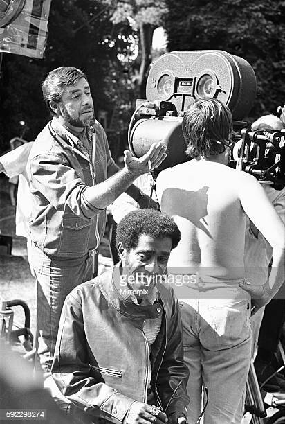 Director Jerry Lewis seen here with Sammy Davis Junior setting up for the next series of shots at Eastnor Castle Ledbury Where they are filming One...