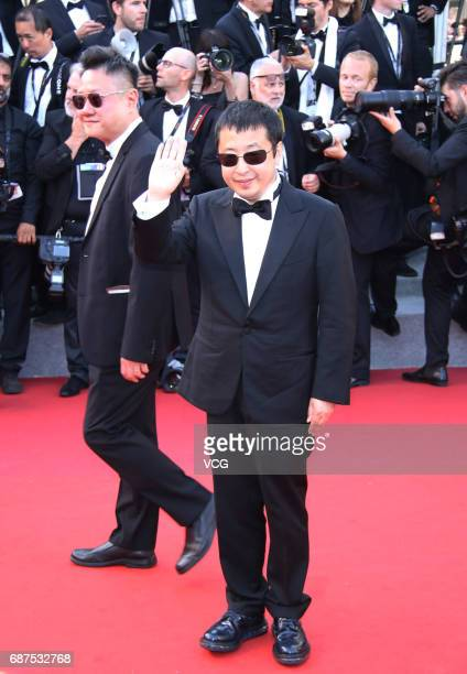 Director Jia Zhangke arrives on the red carpet of the 70th Anniversary dinner during the 70th annual Cannes Film Festival at Palais des Festivals on...