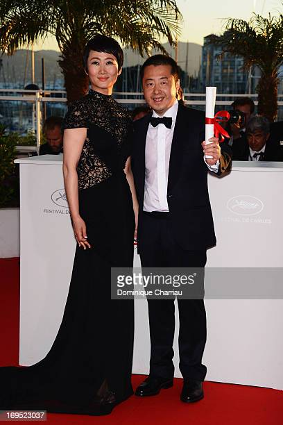 Director Jia Zhangke of 'Tian Zhu Ding' poses with actress Tao Zhao after receiving the best screenplay award at the photocall for award winners...