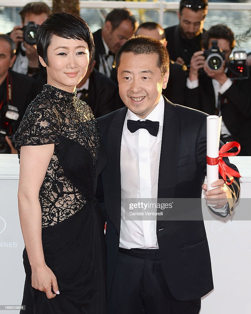 Director Jia Zhangke of 'Tian Zhu Ding' ('A Touch of Sin') poses with actress Tao Zhao after receiving the best screenplay award at the photocall for award winners during the 66th Annual Cannes Film Festival at Palais des Festivals on May 26, 2013 in Cannes, France.