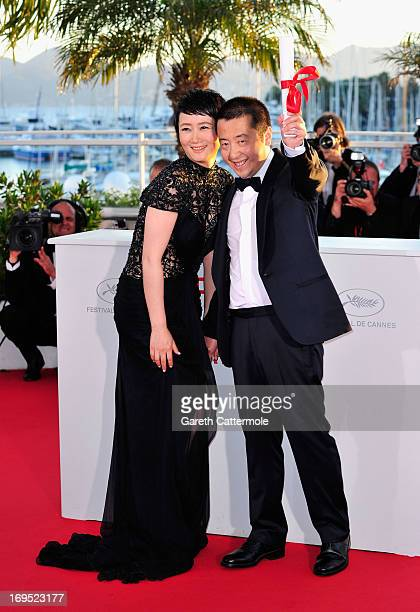 Director Jia Zhangke winner of 'Prix du Scenario' for 'Tian Zhu Ding' and actress Tao Zhao attend the Palme D'Or Winners Photocall during the 66th...