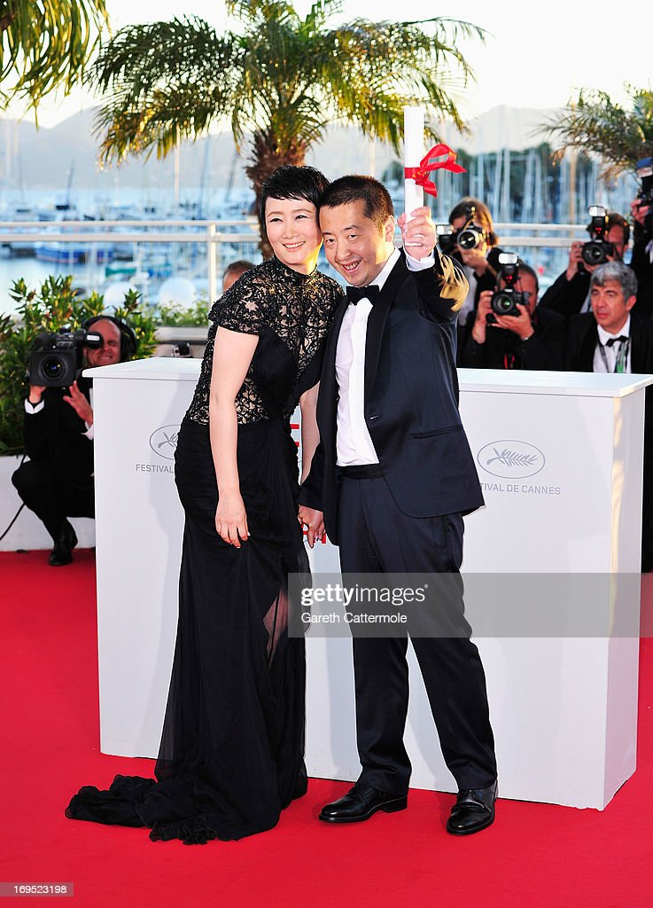 Director Jia Zhangke (R), winner of 'Prix du Scenario' (Best Screenplay) for 'Tian Zhu Ding' ('A Touch of Sin'), and actress Tao Zhao attend the Palme D'Or Winners Photocall during the 66th Annual Cannes Film Festival at the Palais des Festivals on May 26, 2013 in Cannes, France.