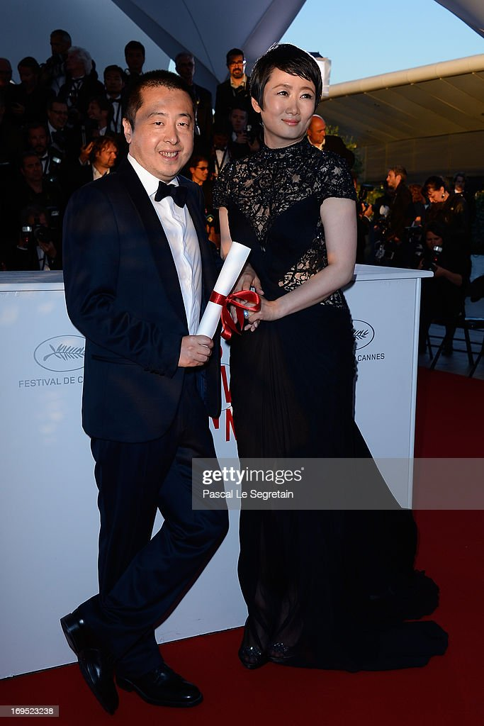 Director Jia Zhangke, winner of 'Prix du Scenario' (Best Screenplay) for 'Tian Zhu Ding' ('A Touch of Sin'), and actress Tao Zhao attend the Palme D'Or Winners Photocall during the 66th Annual Cannes Film Festival at the Palais des Festivals on May 26, 2013 in Cannes, France.