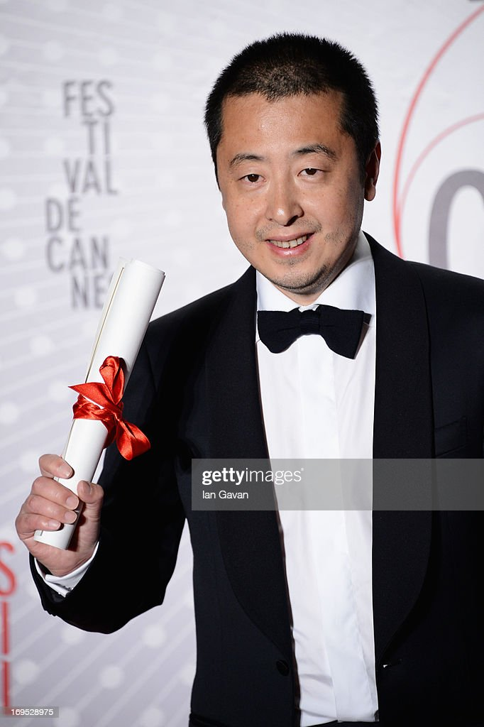 Director Jia Zhangke winner of 'Prix du Scenario' (Best Screenplay) for 'Tian Zhu Ding' ('A Touch of Sin') attends the Palme D'Or Winners dinner during The 66th Annual Cannes Film Festival at Agora on May 26, 2013 in Cannes, France.