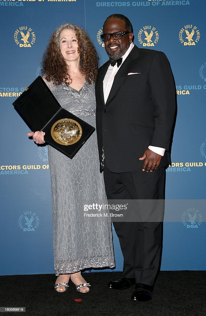 Director Jill Mitwell (L), winner of the Outstanding Directorial Achievement in Daytime Serials for the 'One Life to Live' episode 'Between Heaven and Hell,' and presenter Cedric the Entertainer pose in the press room during the 65th Annual Directors Guild Of America Awards at Ray Dolby Ballroom at Hollywood & Highland on February 2, 2013 in Los Angeles, California.