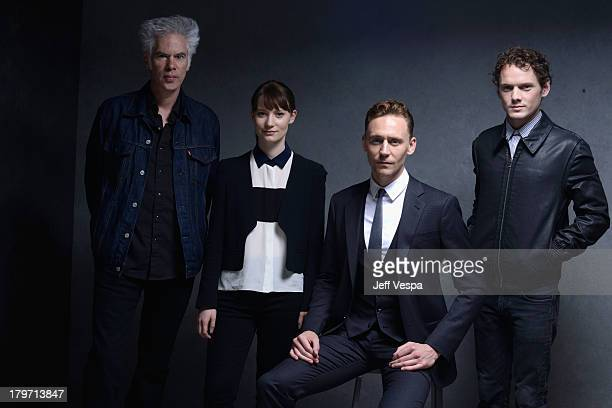 Director Jim Jarmusch actress Mia Wasikowska actor Tom Hiddleston and actor Anton Yelchin of 'Only Lovers Left Alive' pose at the Guess Portrait...