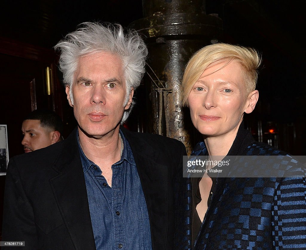 Director <a gi-track='captionPersonalityLinkClicked' href=/galleries/search?phrase=Jim+Jarmusch&family=editorial&specificpeople=208784 ng-click='$event.stopPropagation()'>Jim Jarmusch</a>, actress <a gi-track='captionPersonalityLinkClicked' href=/galleries/search?phrase=Tilda+Swinton&family=editorial&specificpeople=202991 ng-click='$event.stopPropagation()'>Tilda Swinton</a> attend Sony Pictures Classics' 'Only Lovers Left Alive' screening hosted by The Cinema Society and Stefano Tonchi, Editor in Chief of W Magazine after party at Chalk Point Kitchen on March 12, 2014 in New York City.