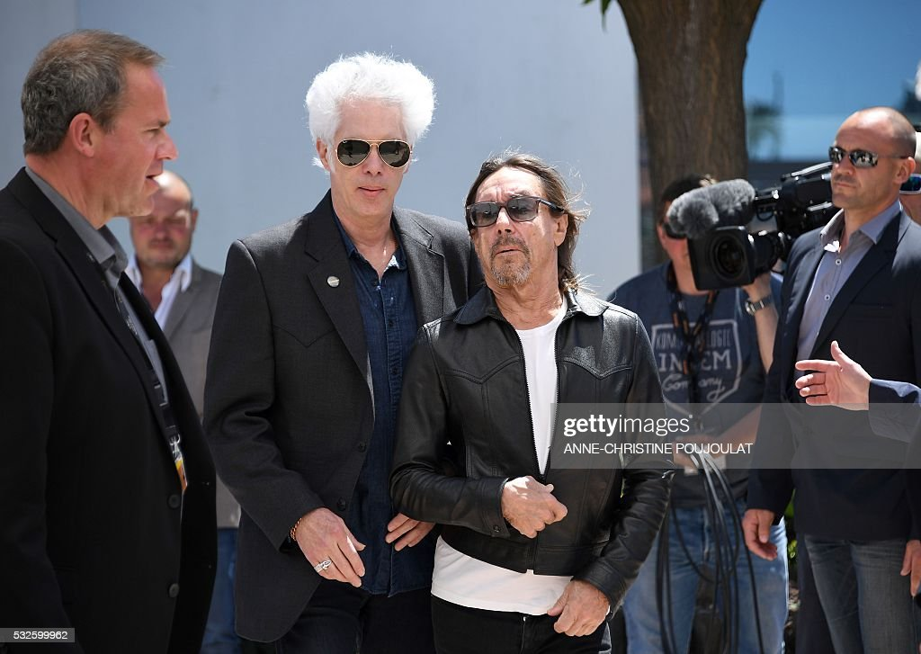 US director Jim Jarmusch (C, L) and US singer Iggy Pop (C,R) arrive on May 19, 2016 to attend a photocall for the film 'Gimme Danger' at the 69th Cannes Film Festival in Cannes, southern France. / AFP / ANNE