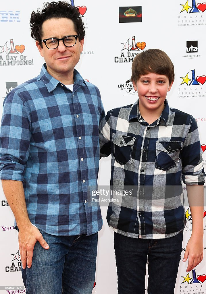 Director JJ Abrams (L) and Actor Ryan Lee attend 'A Day Of Champions' benefiting the Bogart Pediatric Cancer Research Program at the Sports Museum of Los Angeles on October 21, 2012 in Los Angeles, California.