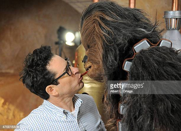 Director JJ Abrams and Chewbacca share a Twizzler on Day One of Disney's 2015 Star Wars Celebration held at the Anaheim Convention Center on April 16...
