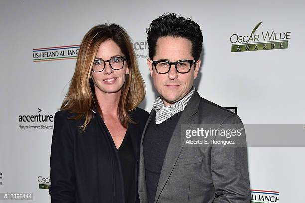 Director JJ Abrams and his wife Katie McGrath attend the Oscar Wilde Awards at Bad Robot on February 25 2016 in Santa Monica California