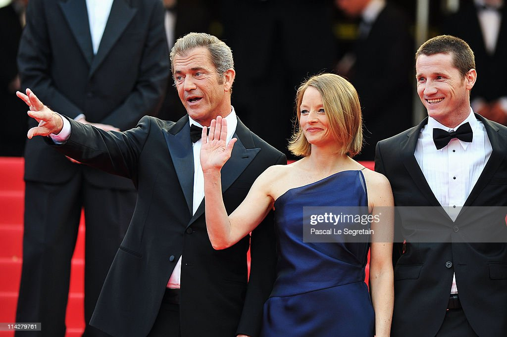 Director Jodie Foster (C) and actor Mel Gibson (L) and writer Kyle Killen attend 'The Beaver' premiere at the Palais des Festivals during the 64th Cannes Film Festival on May 17, 2011 in Cannes, France.