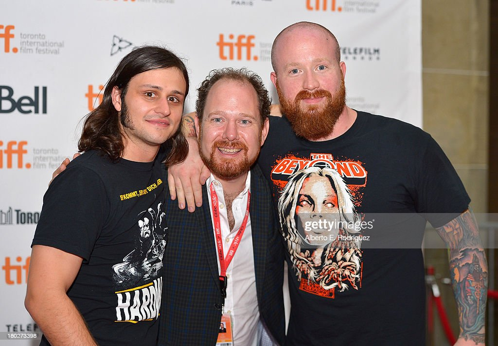 Director Joe Begos, TIFF programmer <a gi-track='captionPersonalityLinkClicked' href=/galleries/search?phrase=Colin+Geddes&family=editorial&specificpeople=4486969 ng-click='$event.stopPropagation()'>Colin Geddes</a> and actor Josh Ethier arrive at the 'Almost Human' Premiere during the 2013 Toronto International Film Festival at Ryerson Theatre on September 10, 2013 in Toronto, Canada.