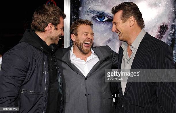 Director Joe Carnahan and actors Bradley Cooper and Liam Neeson attend Open Road Films' 'The Grey' movie premiere at Regal Cinemas LA Live on January...
