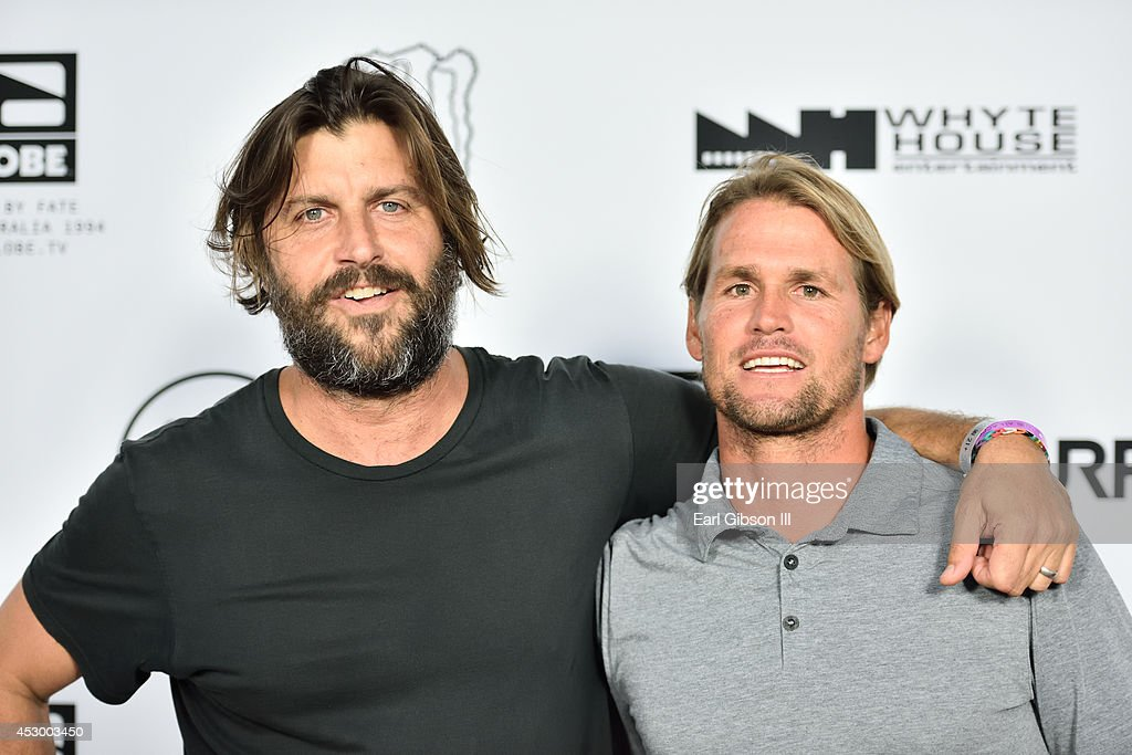 Director Joe G and Globe Surfer Damien Hobgood attend the World Premiere of 'Strange Rumblings In ShangriLa' at Pacific Air Center on July 31 2014 in...