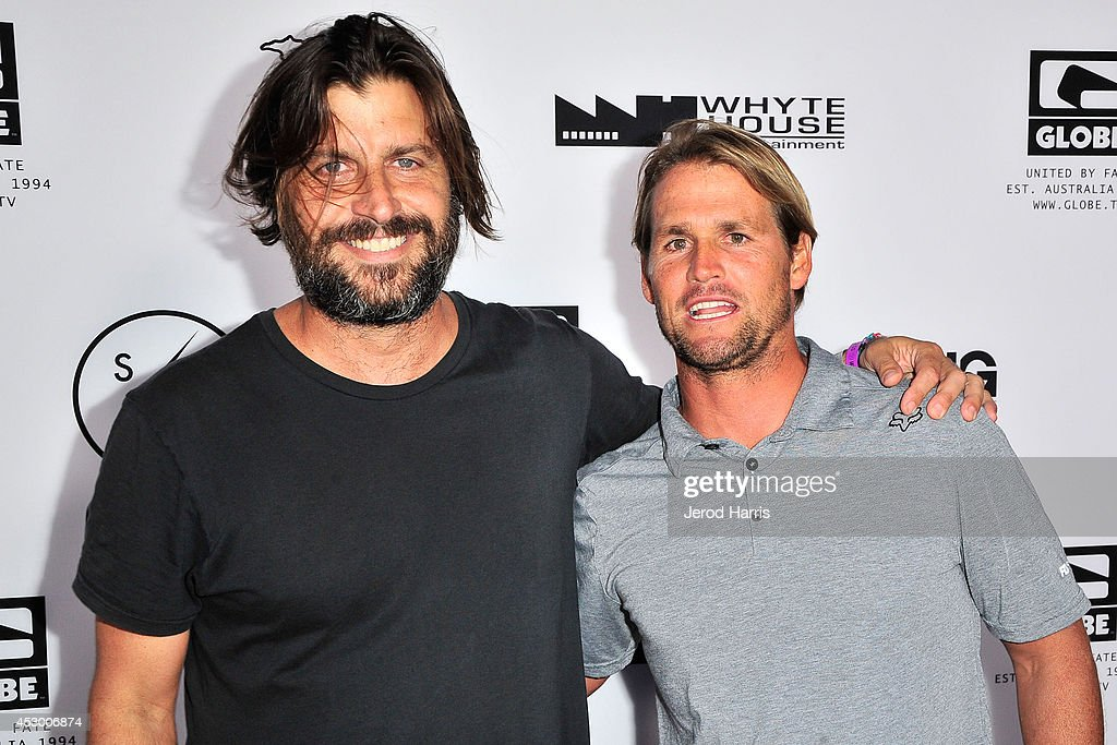 Director Joe G and professional surfer Damien Hobgood attend 'Strange Rumblings In ShangriLa' world premiere at Pacific Air Center on July 31 2014 in...