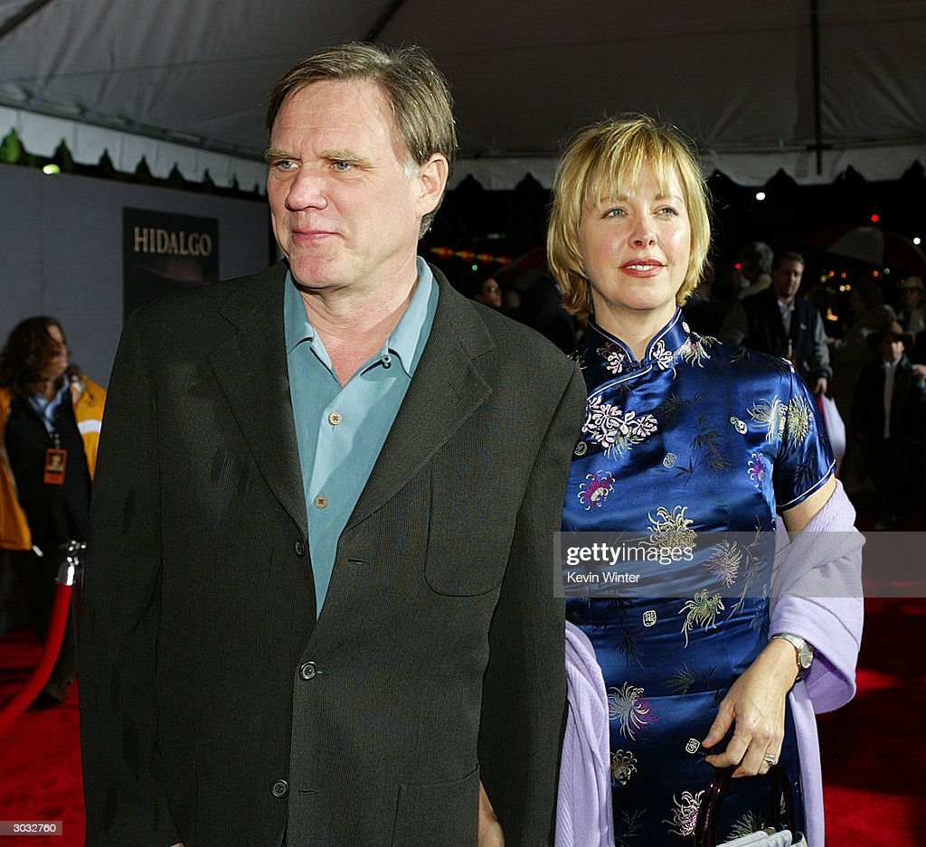 Director Joe Johnston (L) and his wife arrive at the premiere of Touchstone's 'Hildago' at the El Capitan Theatre on March 1, 2004 in Los Angeles, California.