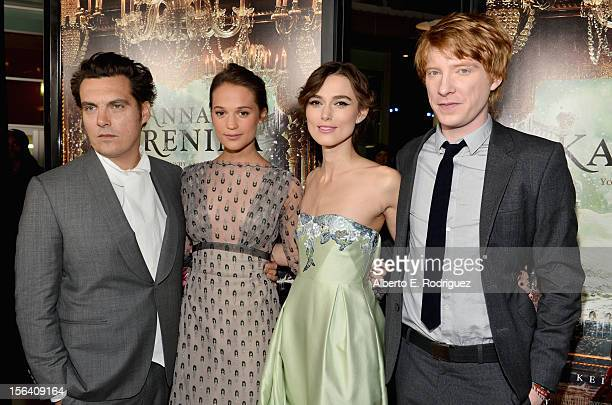 Director Joe Wright and actors Alicia Vikander Keira Knightley and Domhnall Gleeson attend the premiere of Focus Features' 'Anna Karenina' held at...