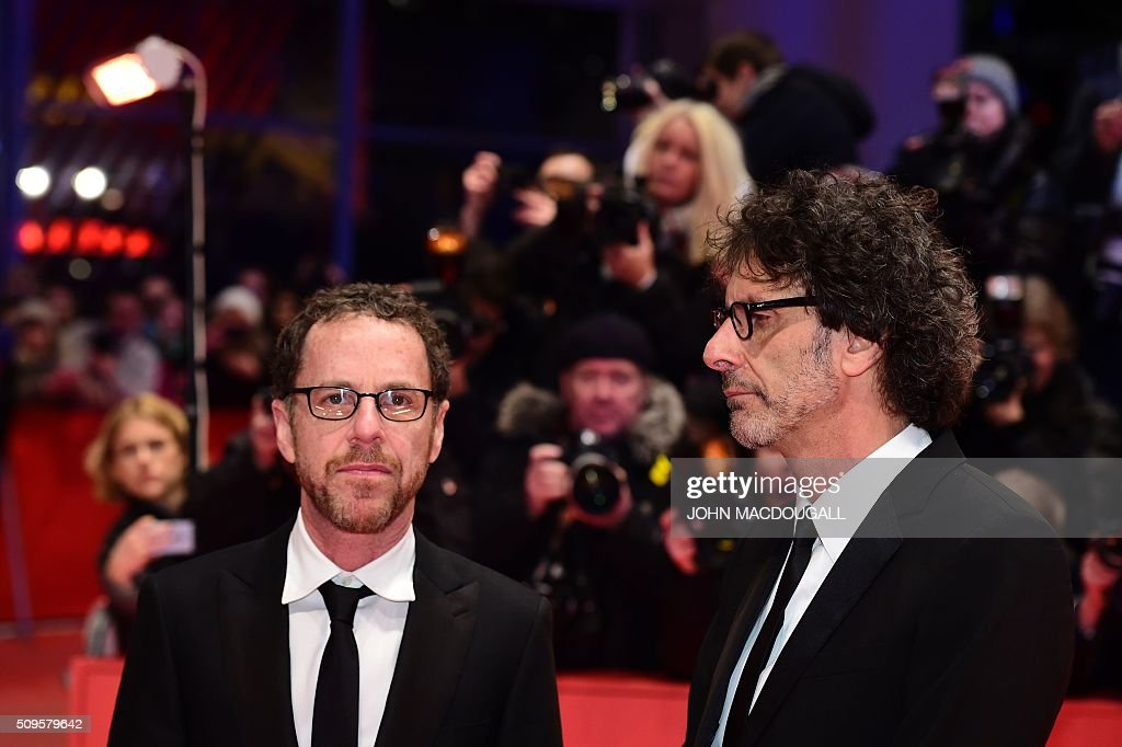 US director Joel Coen (R) and US director Ethan Coen arrives on the red carpet for the film 'Hail, Caesar!' screening as opening film of the 66th Berlinale Film Festival in Berlin on February 11, 2016. Eighteen pictures will vie for the Golden Bear top prize at the event which runs from February 11 to 21, 2016. / AFP / John MACDOUGALL