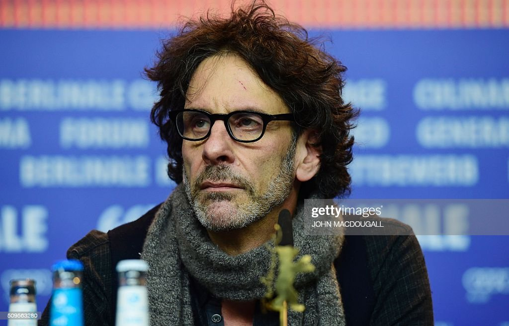 US director Joel Coen attends a press conference for the film 'Hail, Caesar!' screened as opening film of the 66th Berlinale Film Festival in Berlin on February 11, 2016. Eighteen pictures will vie for the Golden Bear top prize at the event which runs from February 11 to 21, 2016. / AFP / John MACDOUGALL
