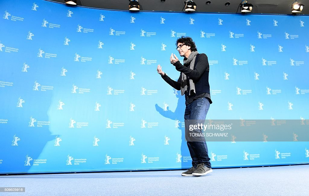 US director Joel Coen poses during the photo call for the film 'Hail, Caesar!' screened as opening film of the 66th Berlinale Film Festival in Berlin on February 11, 2016. The 66th Berlin film festival starts on February 11, 2016 with a spotlight on Europe's refugee crisis. / AFP / TOBIAS SCHWARZ