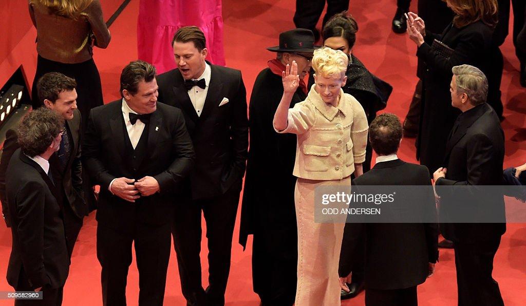 US director Joel Coen, US actor Alden Ehrenreich, US actor Channing Tatum, US actor Josh Brolin, , British actress Tilda Swinton, US actor George Clooney arrive on the red carpet for the film 'Hail, Caesar!' screening as opening film of the 66th Berlinale Film Festival in Berlin on February 11, 2016. / AFP / ODD ANDERSEN