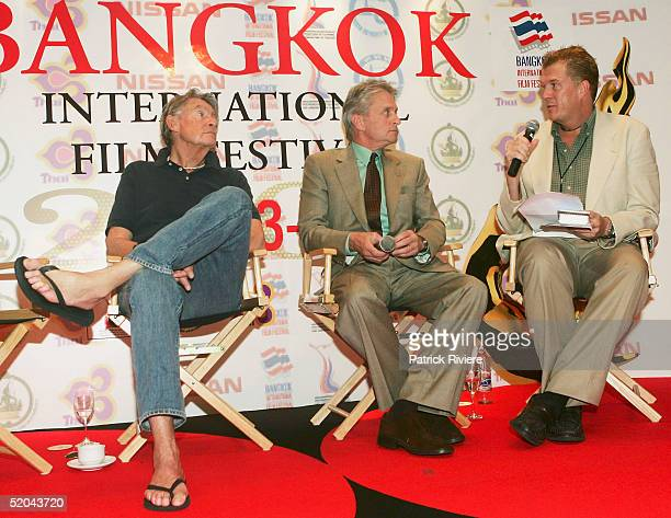 Director Joel Schumacher and actor Michael Douglas answer question to Nicholas Snow at a press conference at the ShangriLa Hotel to talk about...