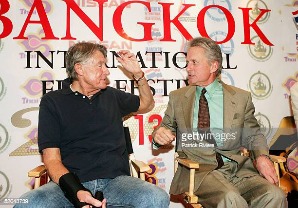Director Joel Schumacher and actor Michael Douglas attend a press conference at the ShangriLa Hotel to talk about 'Phantom of the Opera' presented at...