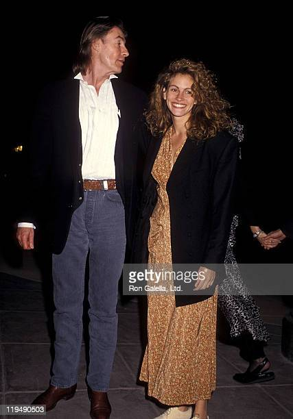 Director Joel Schumacher and actress Julia Roberts attend Sandy Gallin's 50th Birthday Party on May 27 1990 at Eureka Brewery Restaurant in Los...