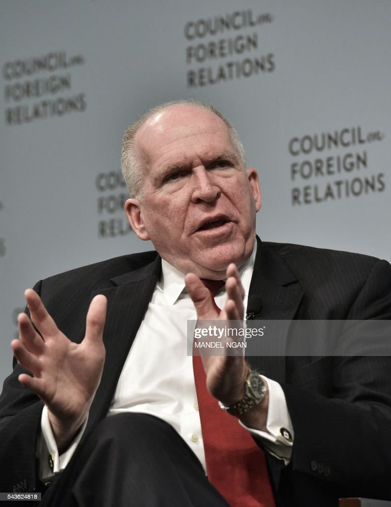 CIA Director John Brennan (L) takes part in a discussion with Judy Woodruff (not seen), co-anchor and managing editor of PBS' 'Newshour', on Instability and Transnational Threats to Global Security at The Council on Foreign Relations on June 29, 2016 in Washington, DC. / AFP / MANDEL